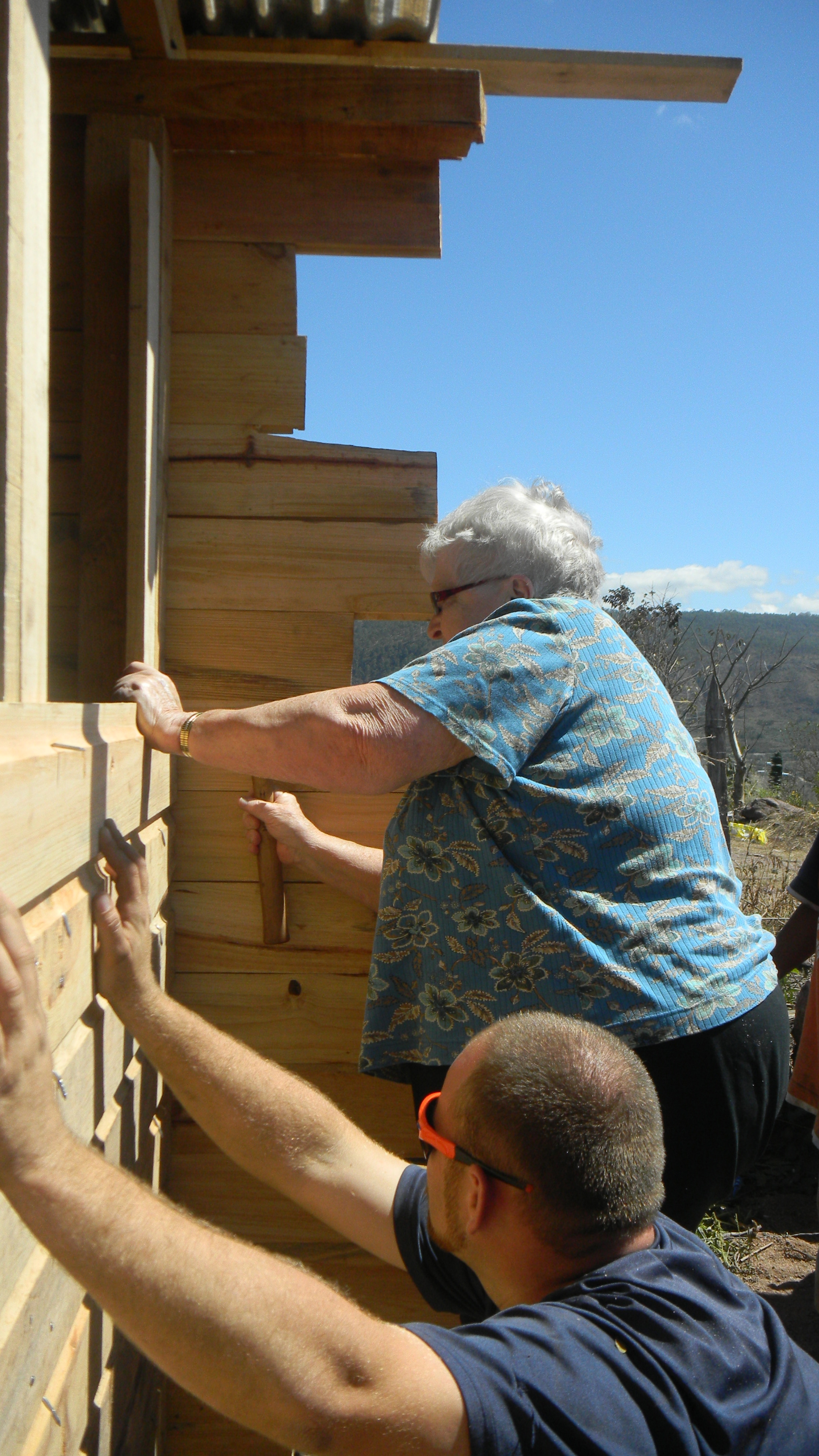 Mom helping build a house for a family in Honduras.  January 2012