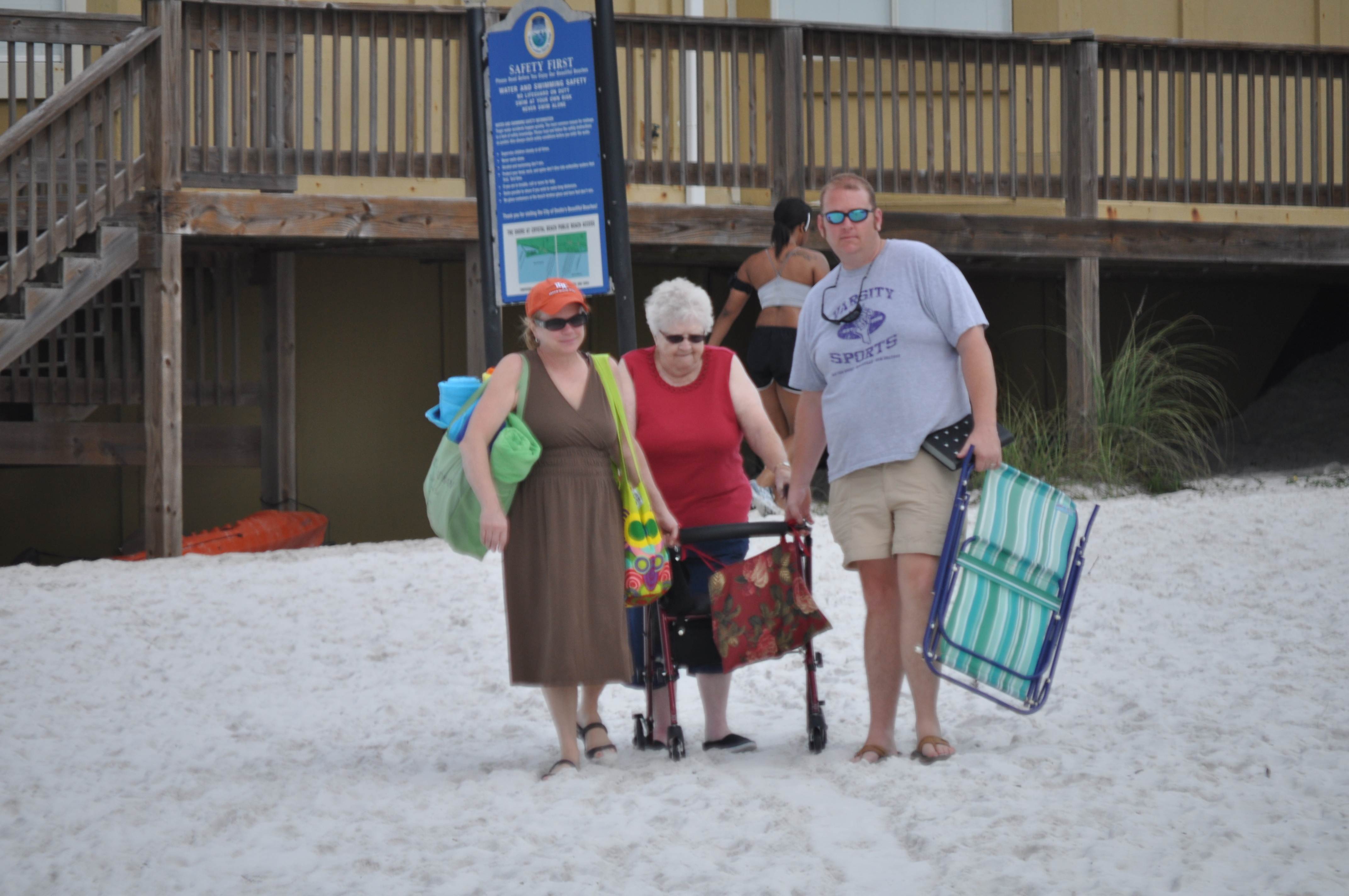 Barb and Richard in March 2012 helping Mom down to the beach at Destin.