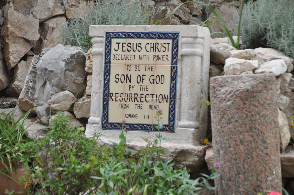 This is located on the path in front of the tomb.